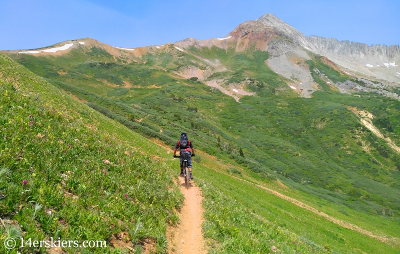 Larry Fontaine mountain biking near Crested Butte with Star Peak in the distance.