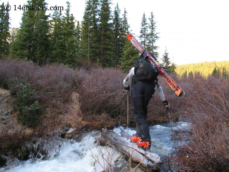 Frank Konsella using crampons to cross stream.