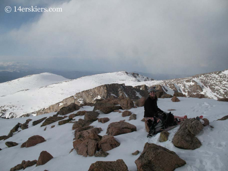 Brittany Konsella on the summit of Mt. Bierstadt getting ready to ski.