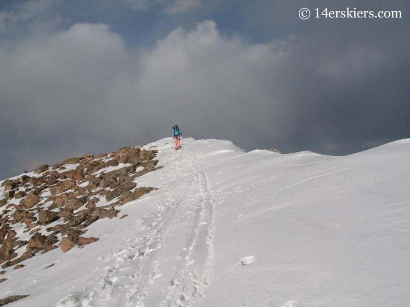 Brittany Walker Konsella backcountry skiing from summit of Mt. Bierstadt.
