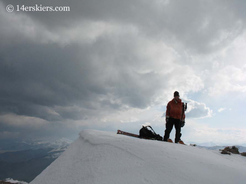 Frank Konsella on the summit of Mt. Bierstadt getting ready to ski.