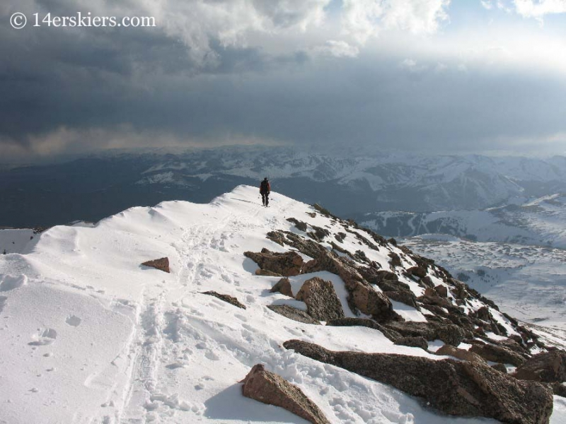 Frank Konsella backcountry skiing off the summit of Mount Bierstadt.