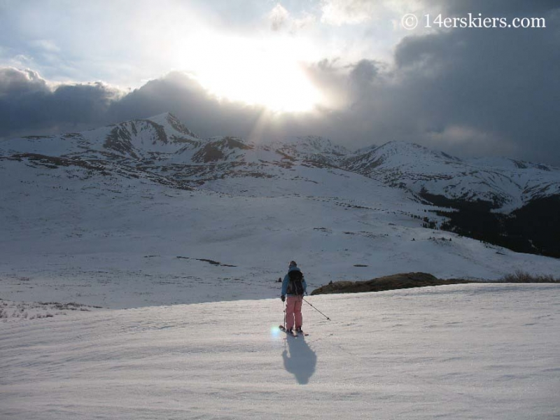 Brittany Walker Konsella skiing off into the sunset on Mt. Bierstadt.