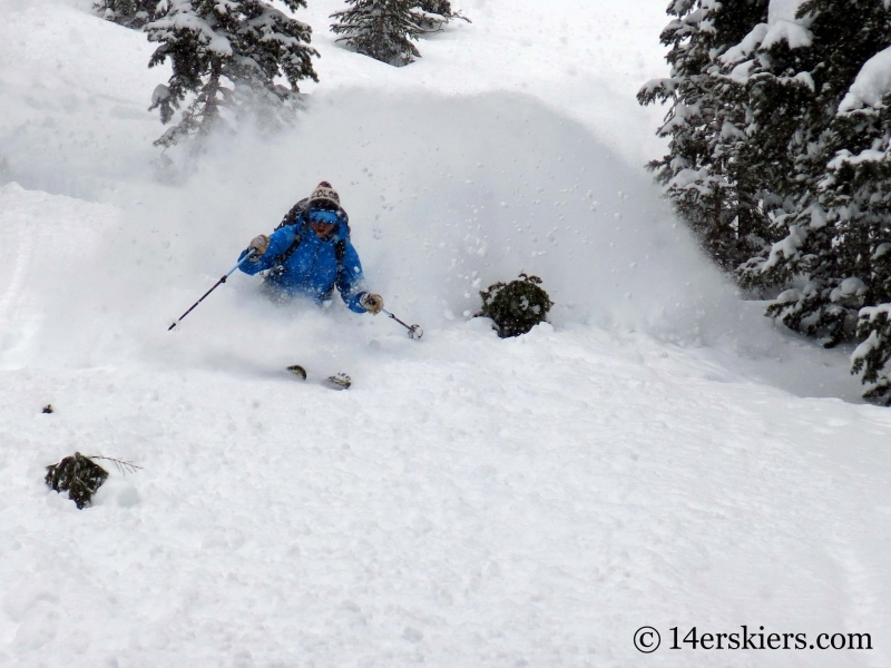 Dave Bourassa getting powder while backcountry skiing in Crested Butte.