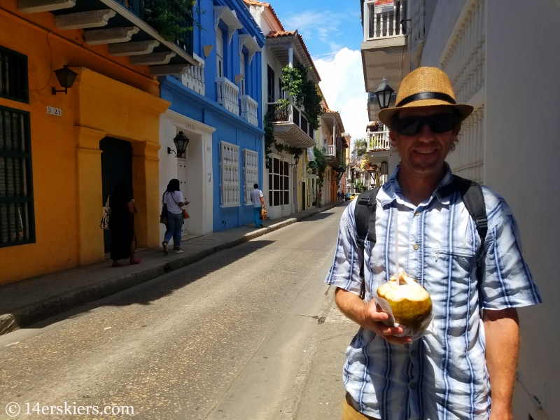 Enjoying coconut on the streets of colorful Cartagena.