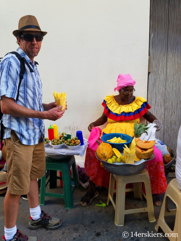 Enjoying papaya on the streets of colorful Cartagena.