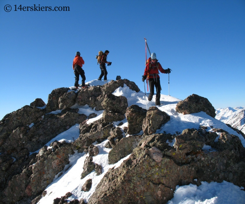 Frank Konsella, Chris Webster, and Pam Rice on the summit of Crestone Peak.