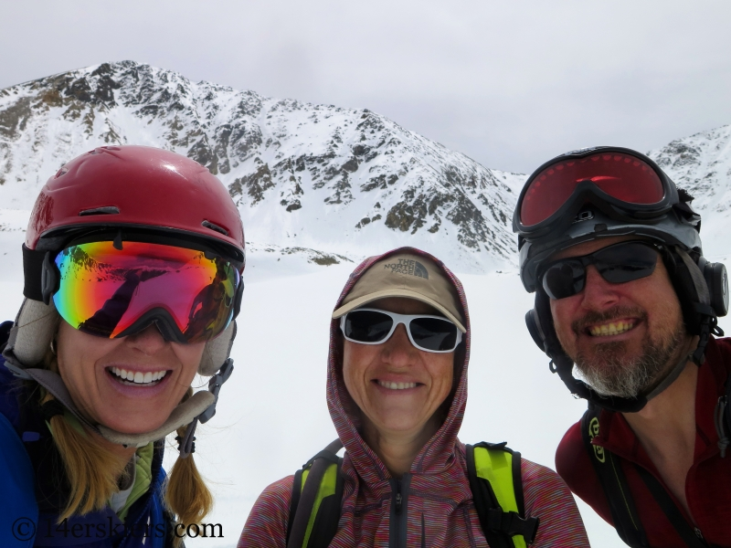Brittany Walker Konsella, Natalie Moran, and Scott Edlin smiling after backcountry skiing the north face of Crystal Peak.