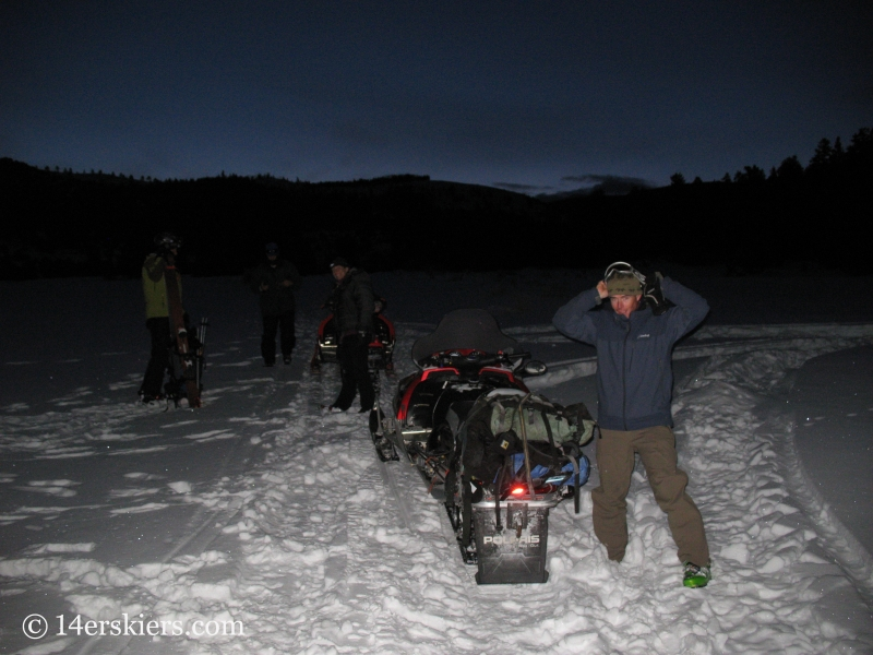 Using snowmobiles to access Culebra Peak.
