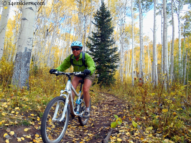 Susan Mol enjoying the downhill during a fall ride on the Dyke Trail near Crested Butte, CO