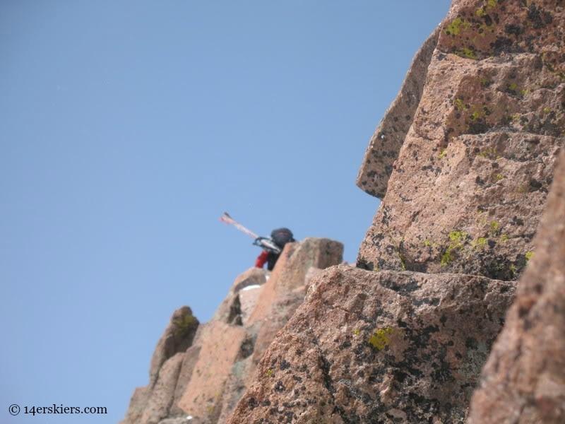 Climbing Mount Eolus to go backcountry skiing.