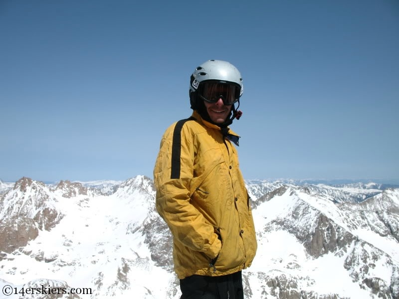 Jarrett Luttrell on the summit of Mount Eolus to go backcountry snowboarding.