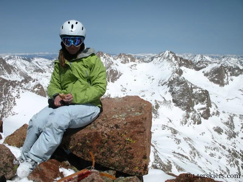Brittany Walker Konsella on the summit of Mount Eolus.
