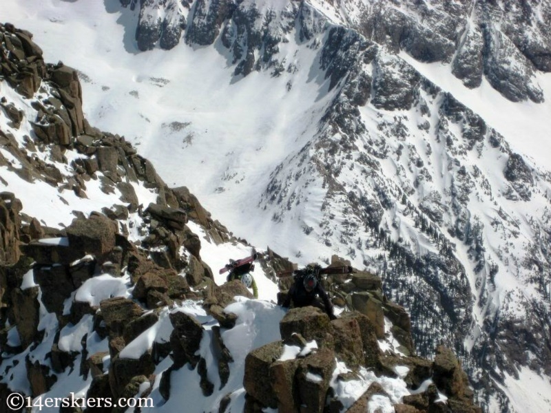 Brittany Walker Konella climing Mount Eolus to go backcountry skiing.