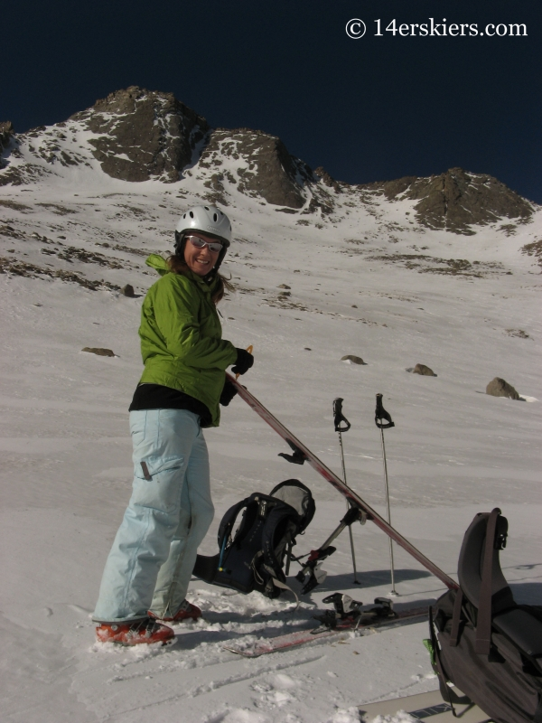 Brittany Konsella putting skins on to ski Mount Evans.