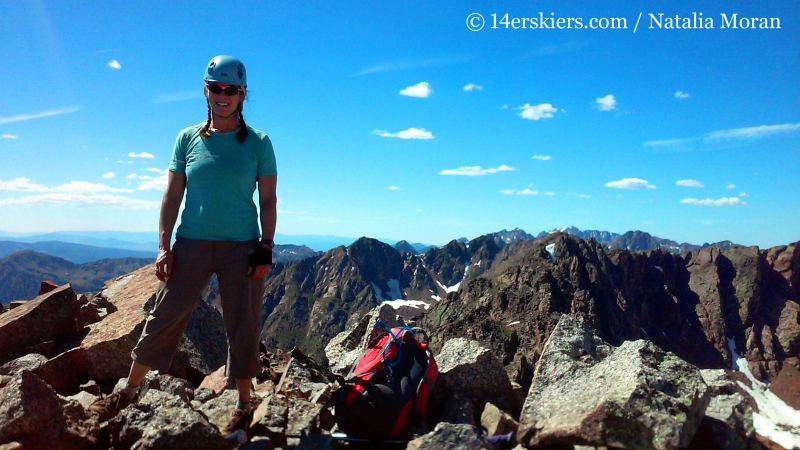 Brittany Konsella on the summit of Grand Traverse Peak.