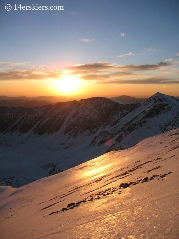 Backcountry skiing on Grays Peak at sunrise.