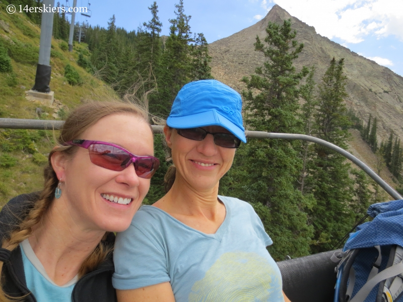 Natalia Moran and Brittany Konsella downloading on chairlift at Crested Butte.