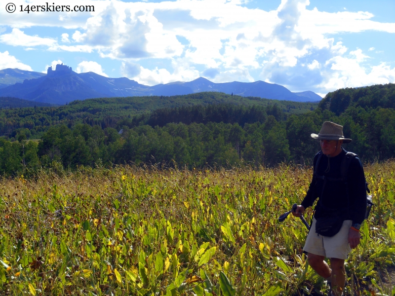 My dad hiking with the Castles in the background, on Swampy Pass trail near Crested Butte.