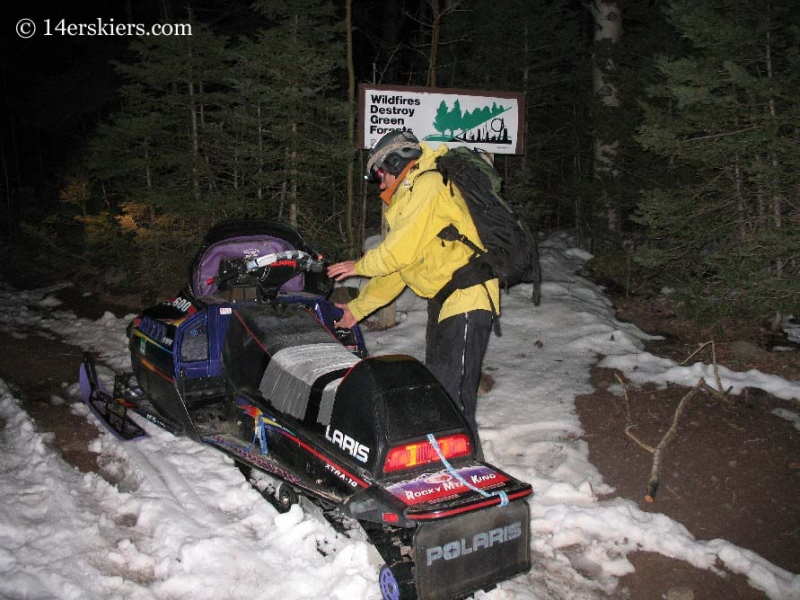 Starting snowmobile in morning.