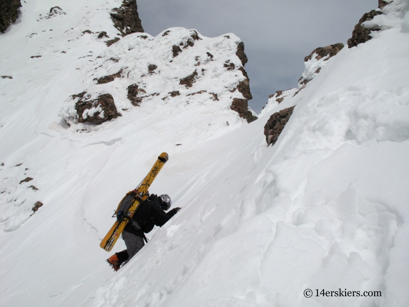 Mark Cavaliero climbing to ski Kit Carson.