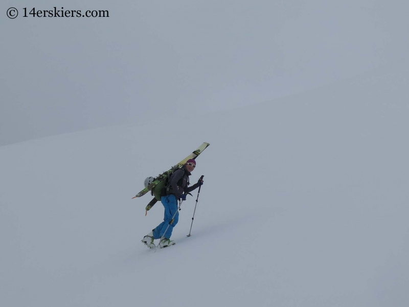 Natalia Moran climbing to go backcountry skiing on Lackawanna Peak.