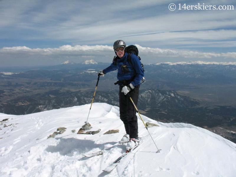Jordan White on the summit of Mount Lindsey.