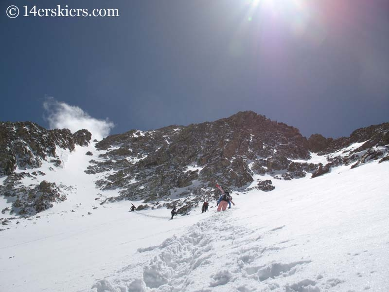 Climbing Mount Lindsey to go backcountry skiing.