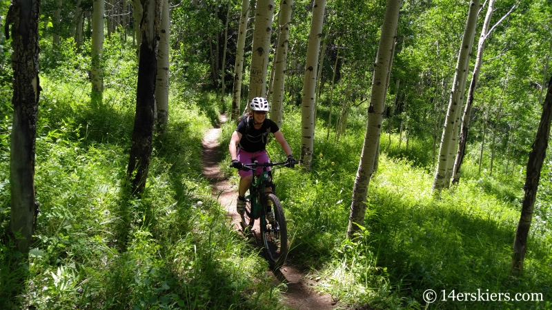 Brittany Konsella mountain biking Snodgrass trail in Crested Butte, CO.