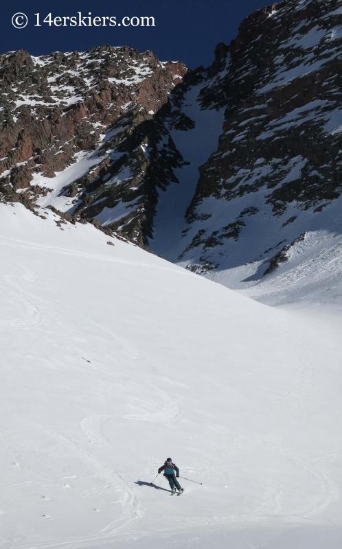 Brittany Konsella skiing with Naked Lady behind.