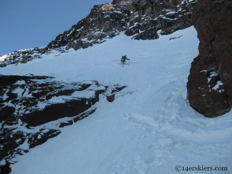 Brittany Konsella backcountry skiing on North Maroon.