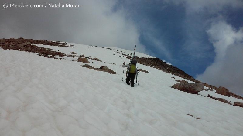 Brittany Konsella climbing Mount Oklahoma to go backcountry skiing.
