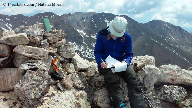 Signing the summit register on Mount Oklahoma.
