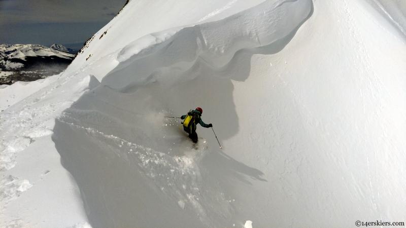 skiing under a cornice