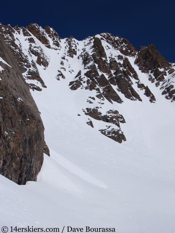 BBackcountry skiing East Partner Peak (Peak V) in the Gore Range.