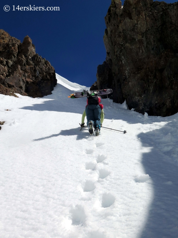 Brittany Konsella climbing a couloir to go backcountry skiing in the Crested Butte backcountry.