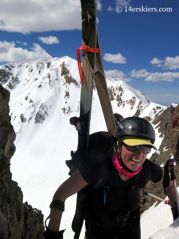 Susan Mol climbing to go backcountry skiing in Crested Butte.