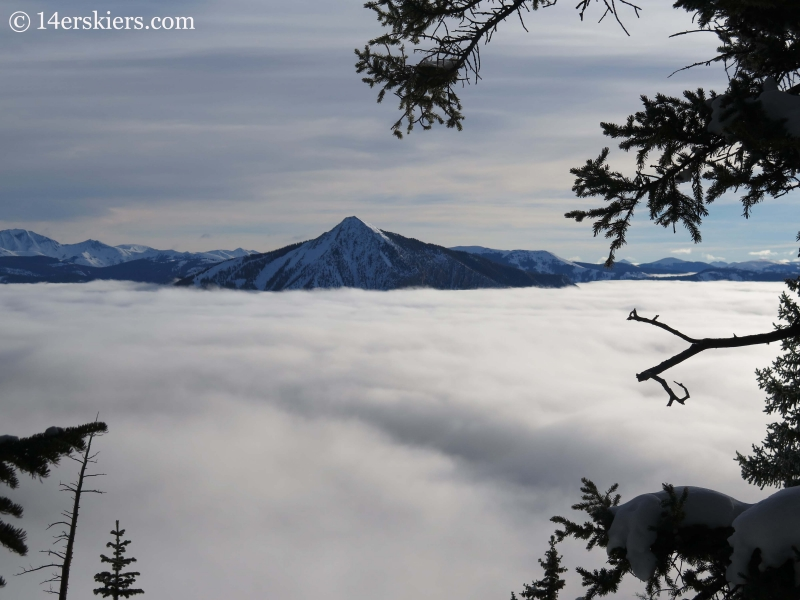 Mount Crested Butte with fog in winter while backcountry skiing