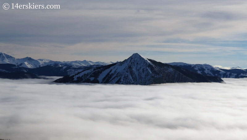 Mount Crested Butte in winter with fog.