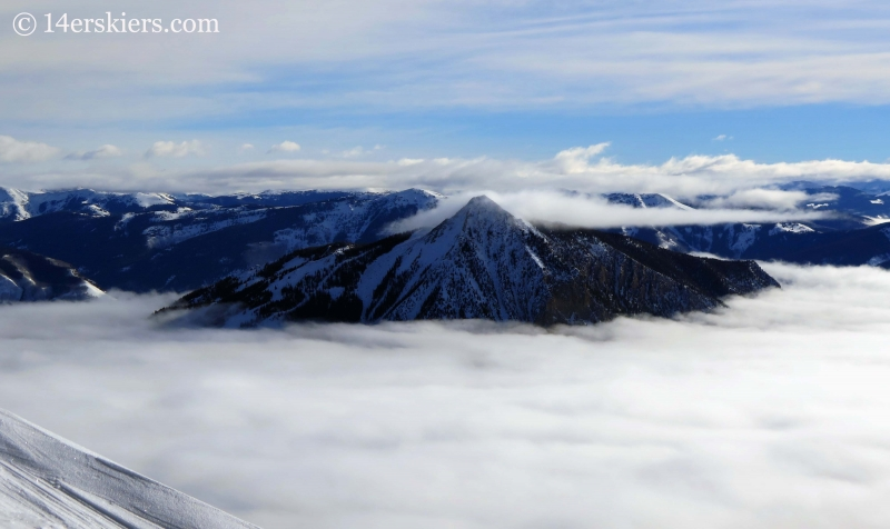 Mount Crested Butte with fog in winter seen from Red Lady while backcountry skiing in Crested Butte.