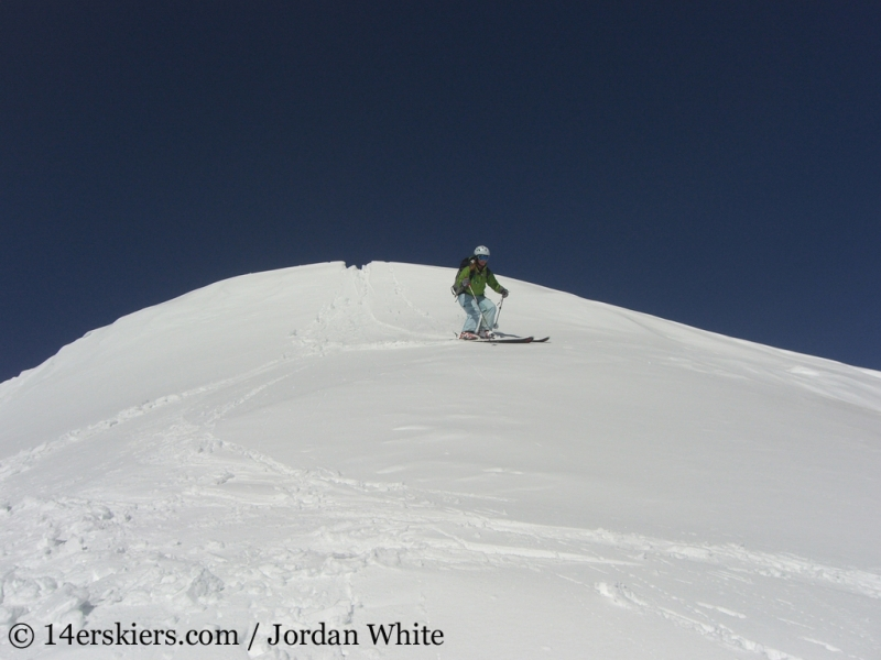 Brittany Walker Konsella backcountry skiing on Sunshine Peak.