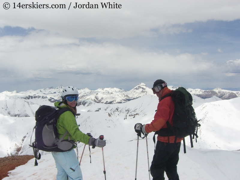 Brittany Walker Konsella and Frank Konsella on top of Redcloud, ready to ski.