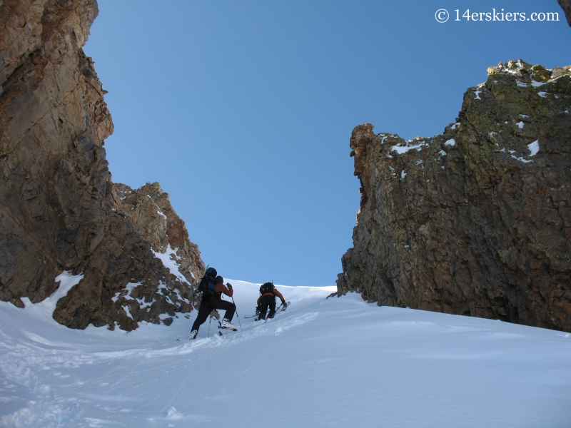 Climbing a couloir to ascend Sunshine Peak.