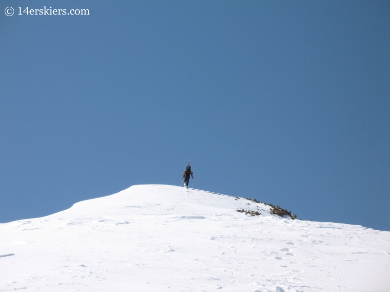 Jordan White summiting Sunshine Peak.