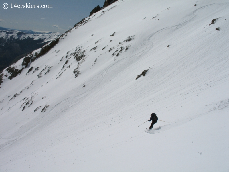 Jordan White backcountry skiing on Sunshine Peak.