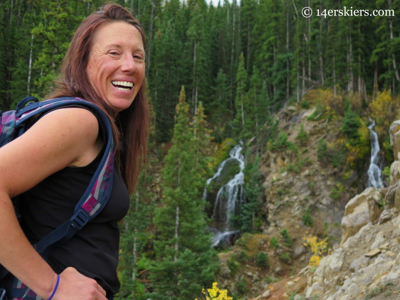 Susan Mol with waterfall near Three Lakes Trail