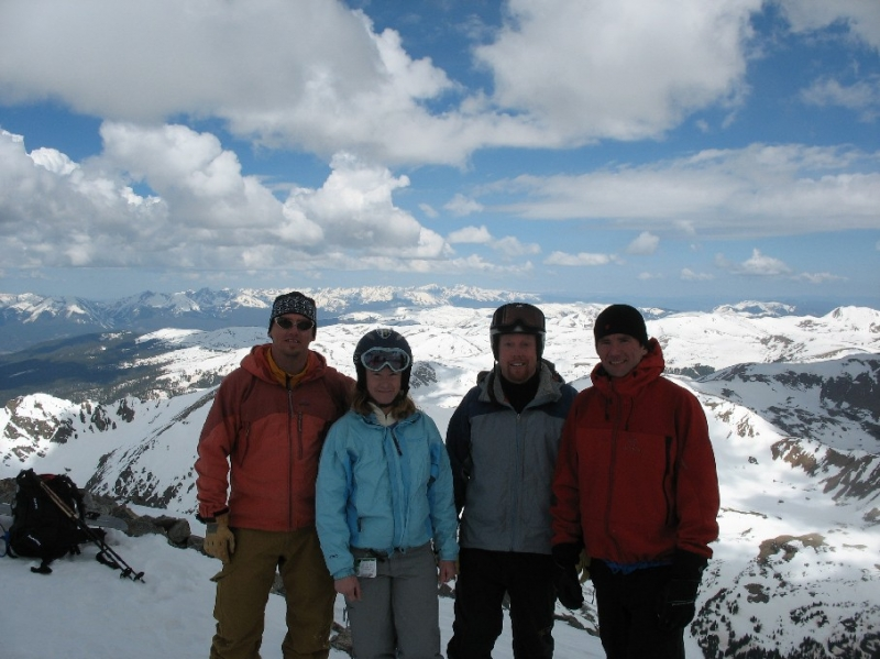 Four skiers on top of Torryes Peak while backcountry skiing in Colorado