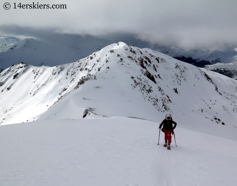 Jenny Veilleux skiining to go backcountry skiing on Twining Peak.
