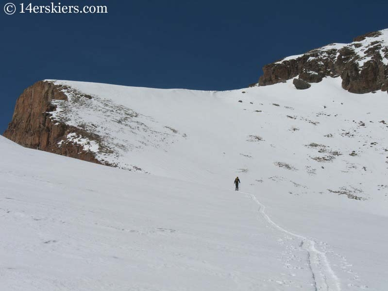Skinning up east side of Uncompahgre Peak to go backcountry skiing.