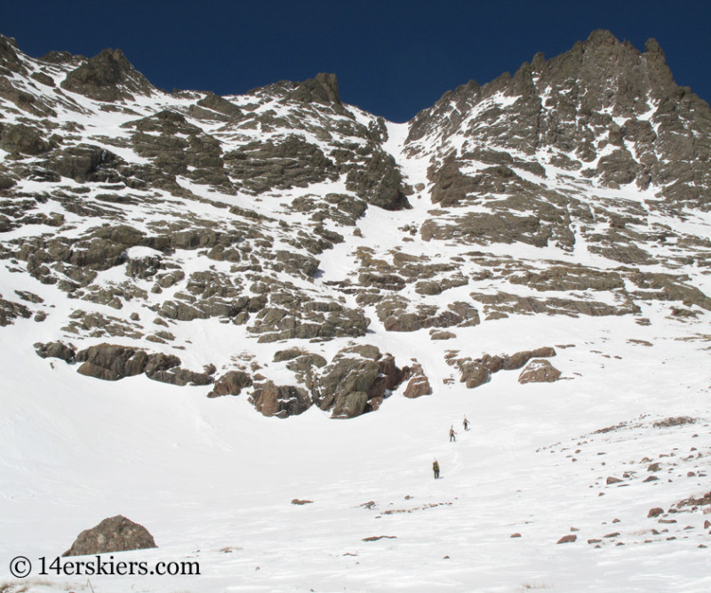 Climbing Crestone Peak south couloir to go backocuntry skiing.